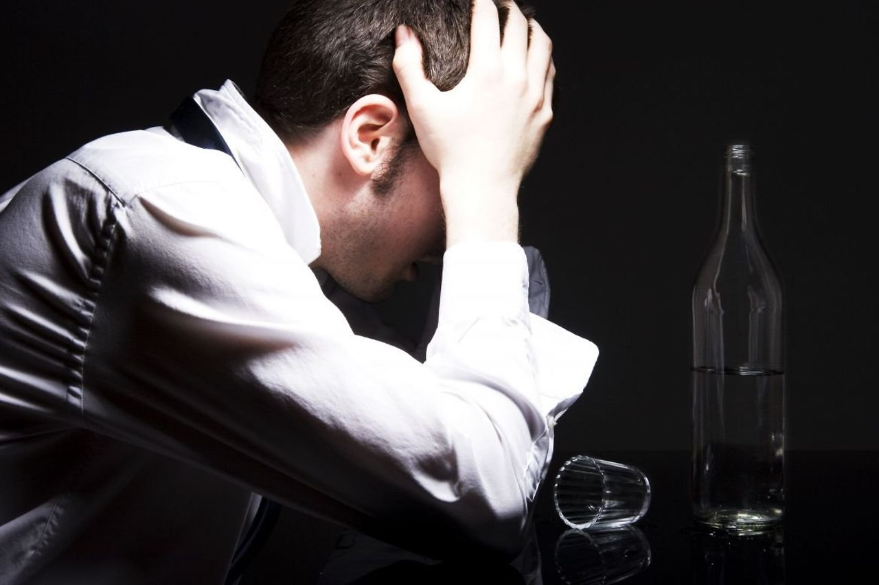 Alcohol dependence (alcoholism). Alcohol addiction. A man with a drinking problem.