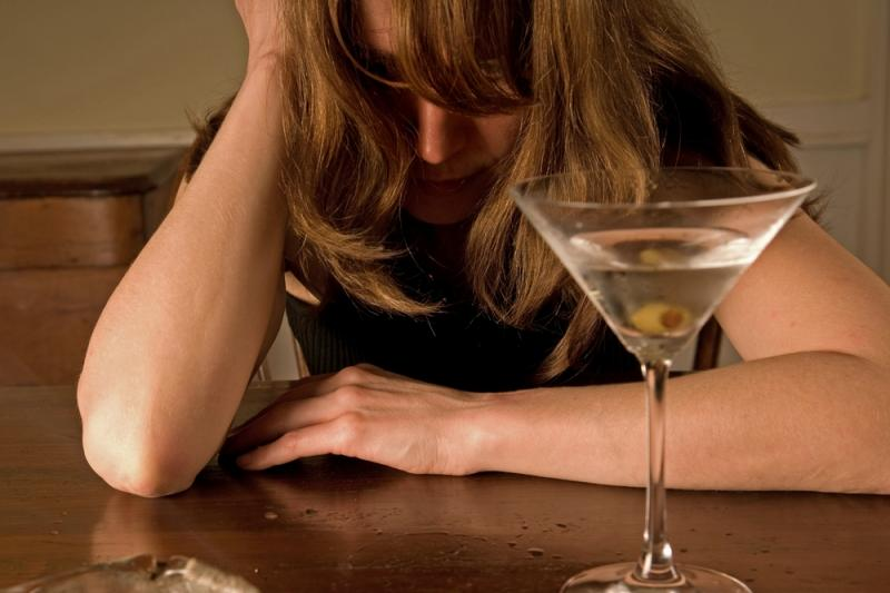 Alcoholism is a terrible disease. Woman alcoholic.
