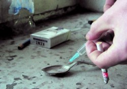 addict with heroin syringe fills